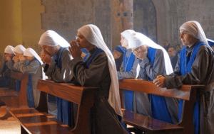 Nuns Ordained As Priests Praying (Photo)