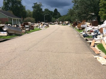 Piles of flood-damaged debris line the road of a Baton Rouge neighborhood where the SBCV disaster relief teams worked to help clean out homes.
