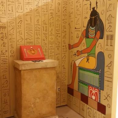 escape room wall with hieroglyphics