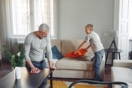 father and son cleaning house
