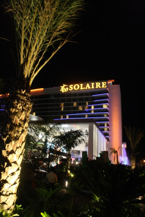 Solaire facade at night.
