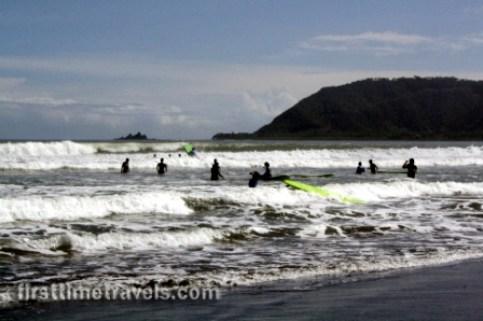 Surfers enjoy riding the waves at Sabang Beach.