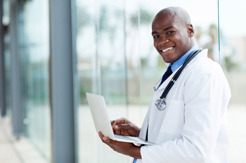 portrait of afro american doctor using laptop computer