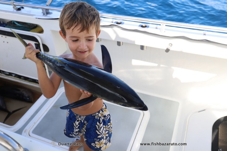 Little Duarte posing with one of the smallest Yellowfin Tuna we got for the day