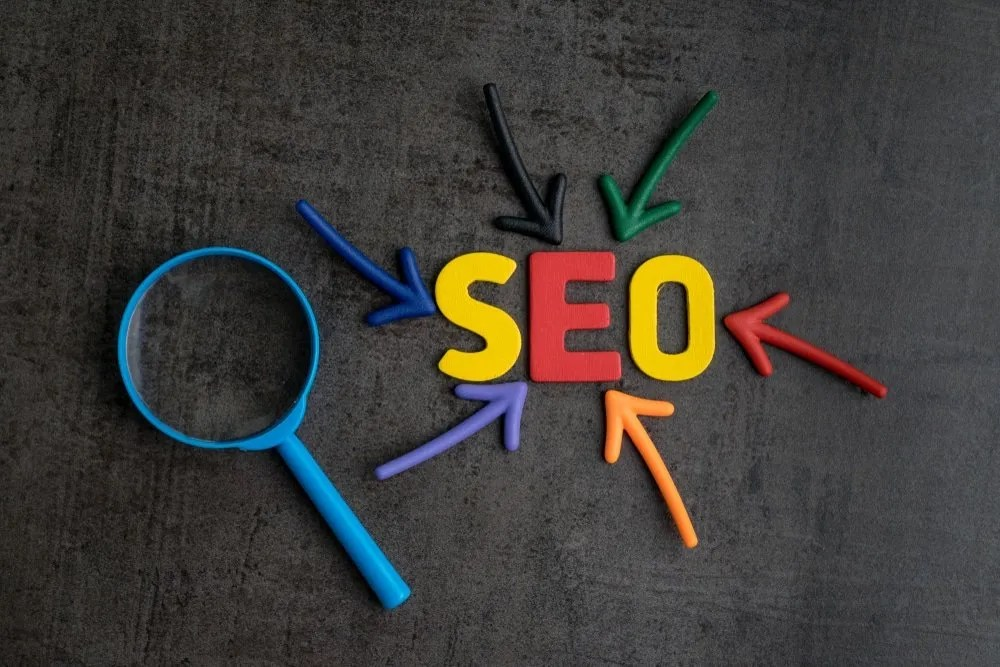 SEO Search Engine Optimization with Magnifying Glass and Google Colors