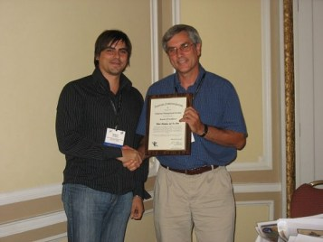 Leader Ron Essig gives a Society Award for the AFS American Fisheries Society