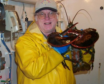 Joseph Kunkel with large American lobster aboard Delaware II, Spring 2003 Leg 4, taken with his camera by a shipmate.
