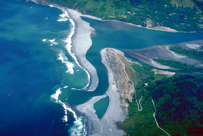 The mouth of the Klamath River on the Pacific Ocean, Del Norte County, California. River mouths are just one example of the interconnection between inland and marine waters discussed in our symposium. Credit: U.S. Army Corps of Engineers