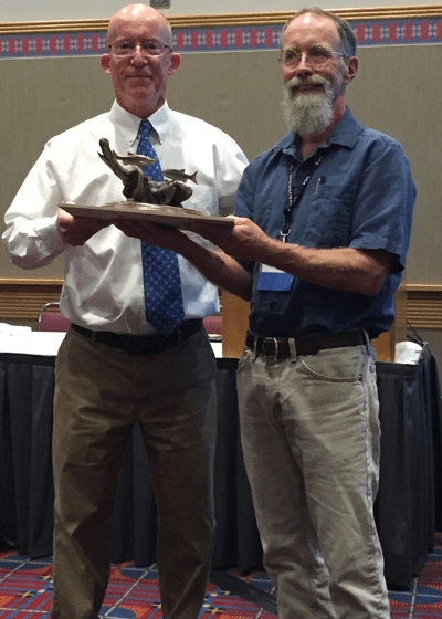 Oregon Chapter AFS Native Fish Committee Chair James Capurso (left) presents Paul Scheerer (Oregon Department of Fish and Wildlife) with the 2015 Oregon Chapter AFS Native Fish Conservationist of the Year Award during the symposium. Credit: Michael Gauvin