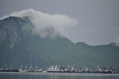 Fog rolling over mountain leaving wispy trail as it invades Dutch Harbor, Alaska. Credit: Tom Ward, NOAA Teacher-at-Sea; Image ID: wea04411, NOAA's National Weather Service (NWS) Collection