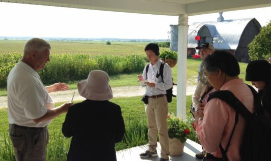 Brent Hoerr discusses biotechnology with a Japanese media team