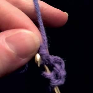 Pulling yarn thru the chain