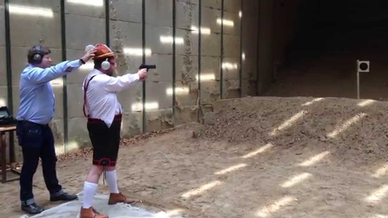 That's a large-caliber Desert Eagle he's holding…but keep your eye on the hat