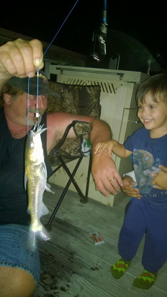 Soren 39 s first fish caught on his spiderman pole poppi got for Spiderman fishing pole
