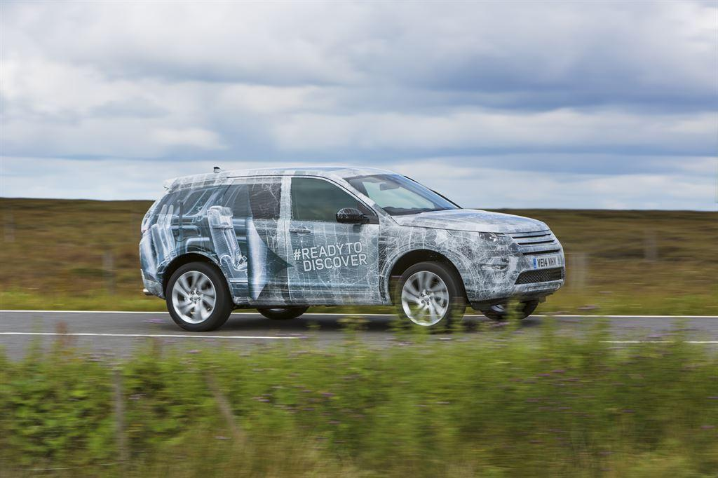 Camo covered Land Rover Discovery with optional third row.