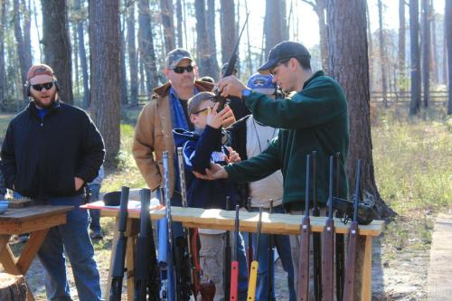 Measuring campers for the proper rifle fit.
