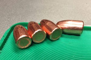 RMR 147 grain bullets showing the extra folding of plating at the base.