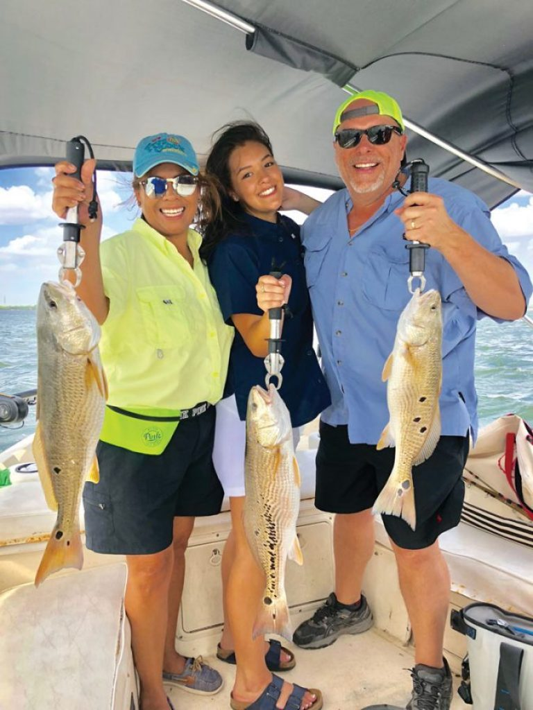 Mary and Chris Blood, with daughter Britney (center) caught their limit of reds, the largest a 10-pounder, in three hours on Lake Calaveras. Mary caught her first fish that day, despite grow-ing up on the Pacific Ocean where her dad was chef on a fishing boat!