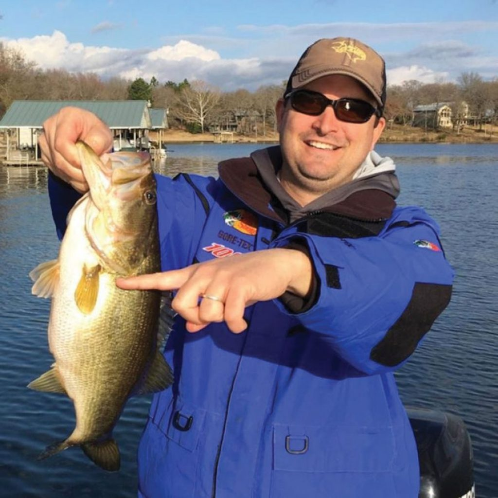 """Bryan Lewis of Crandall was reeling in this five pounder at Lake Athens when a much larger bass attacked the fish and engulfed its entire head. The bigger fish, estimated to be in the """"double digits"""" by Lake Athens fishing guide Jim Brack, released the smaller fish in plain view at the side of the boat."""