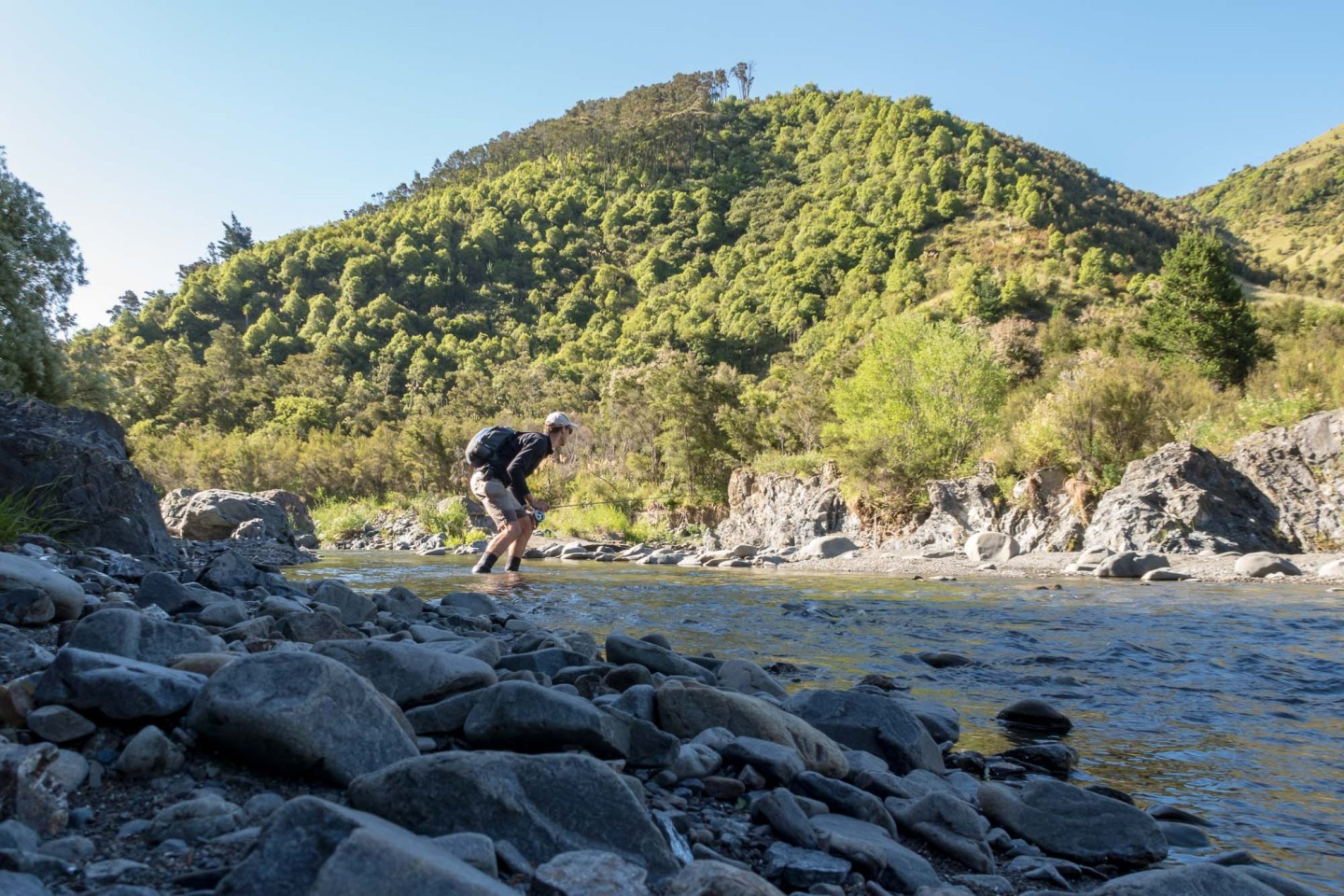 Man fly fishing at the upper Mohaka River, New Zealand