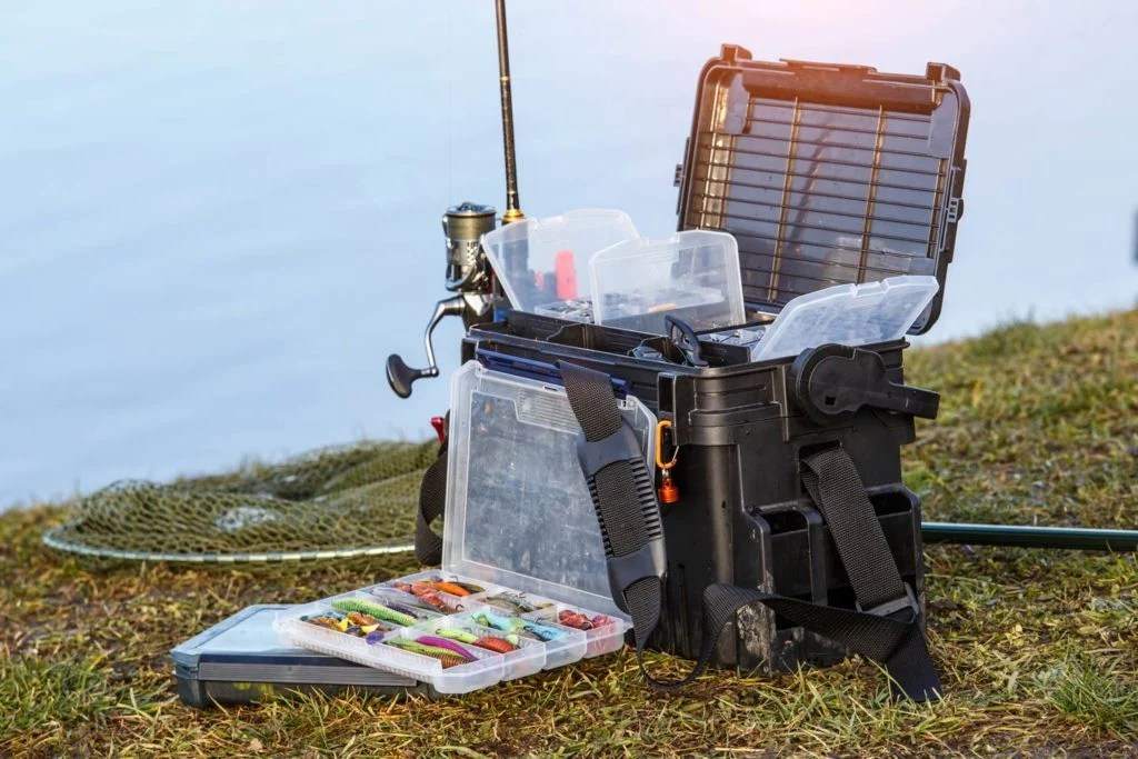 A fully stocked fisherman's tackle box, with lures and light and heavy tackle.