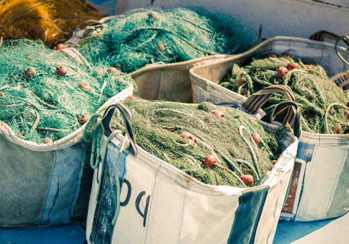 Four bags full of commercial fishing nets on a boat