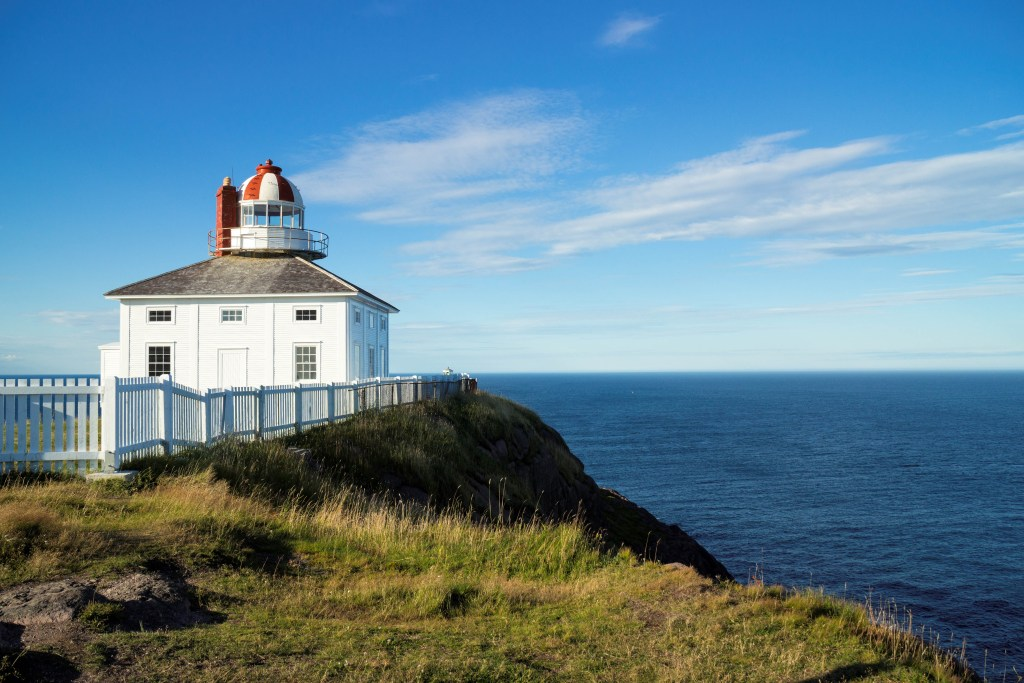 A view of a lighthouse and the sea on the Avalon Peninsula