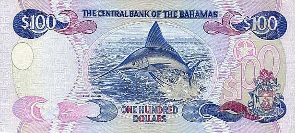 A 100 Bahamian dollar bill with a Blue Marlin on it