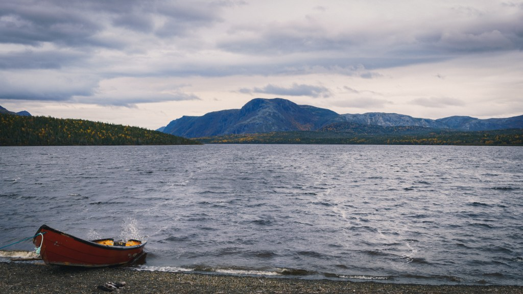 A solitary boat on the the shore of a river in Newfoundland