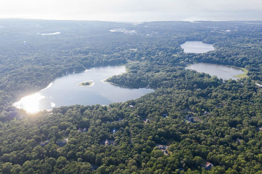 An aerial view of Cape Cod's freshwater ponds and greenery