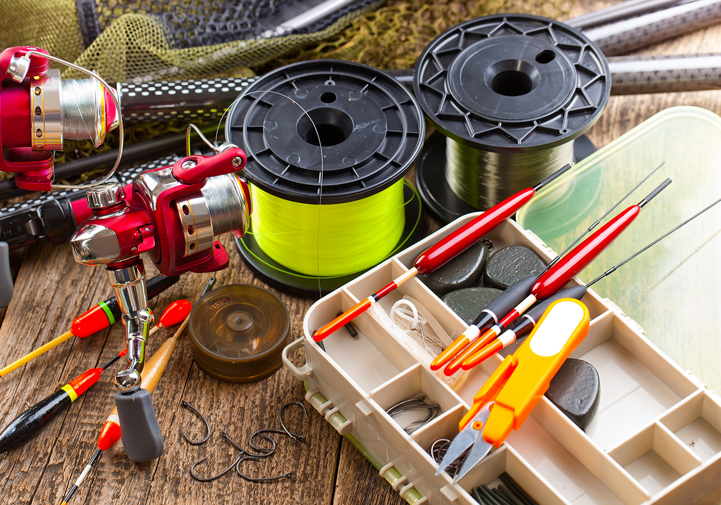 A selection of fishing tackle: fishing line, bobbers, hooks, and more.