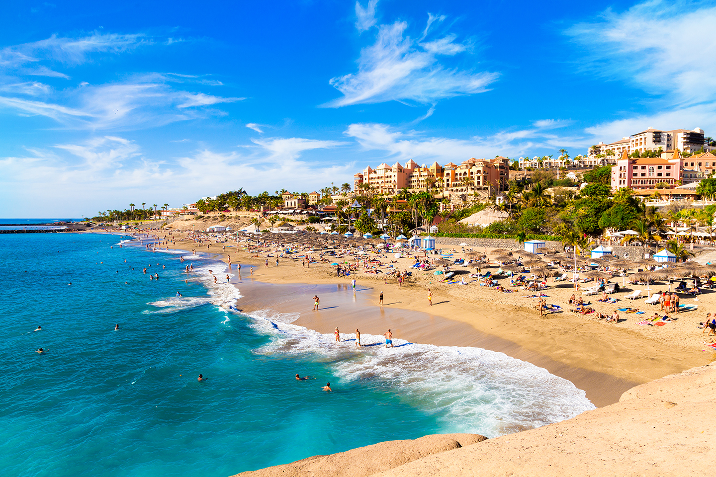 a beach in Costa Adeje, Tenerife, one of the best places for fishing holidays Europe has to offer.
