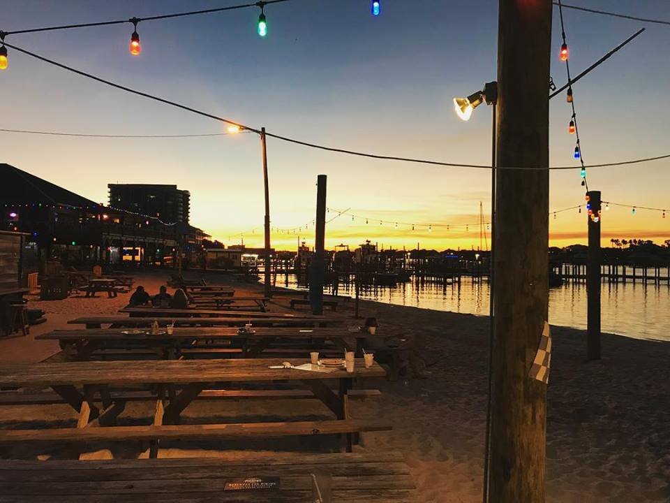 a sunset at Flora-Bama restaurant, one of the hook and cook restaurants in Orange Beach