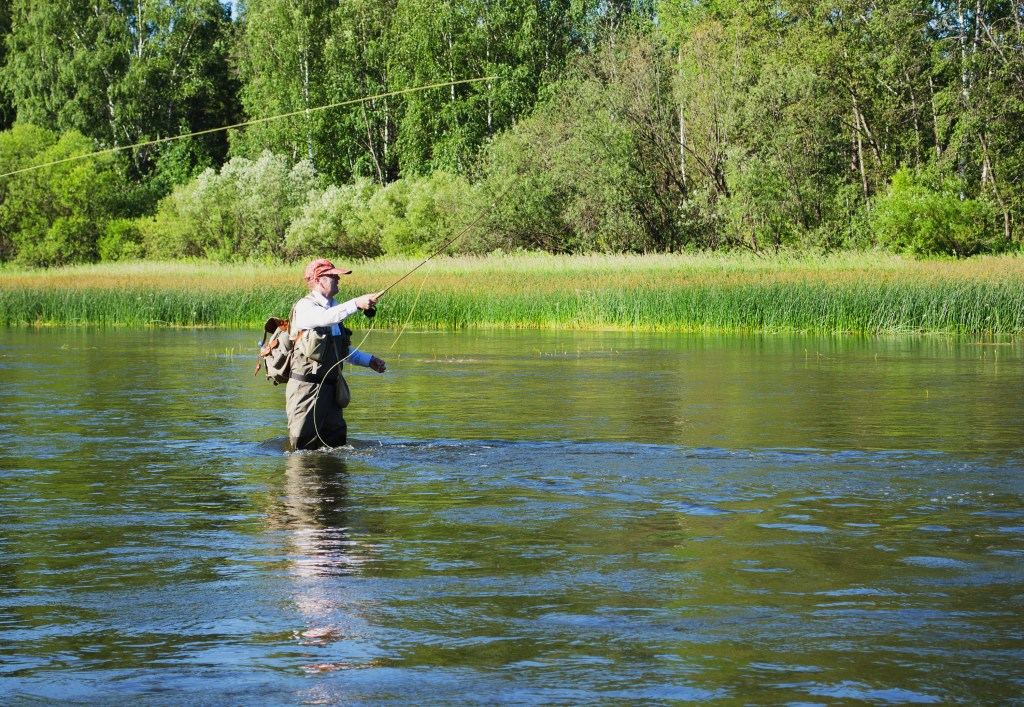 A fly angler wading in a river