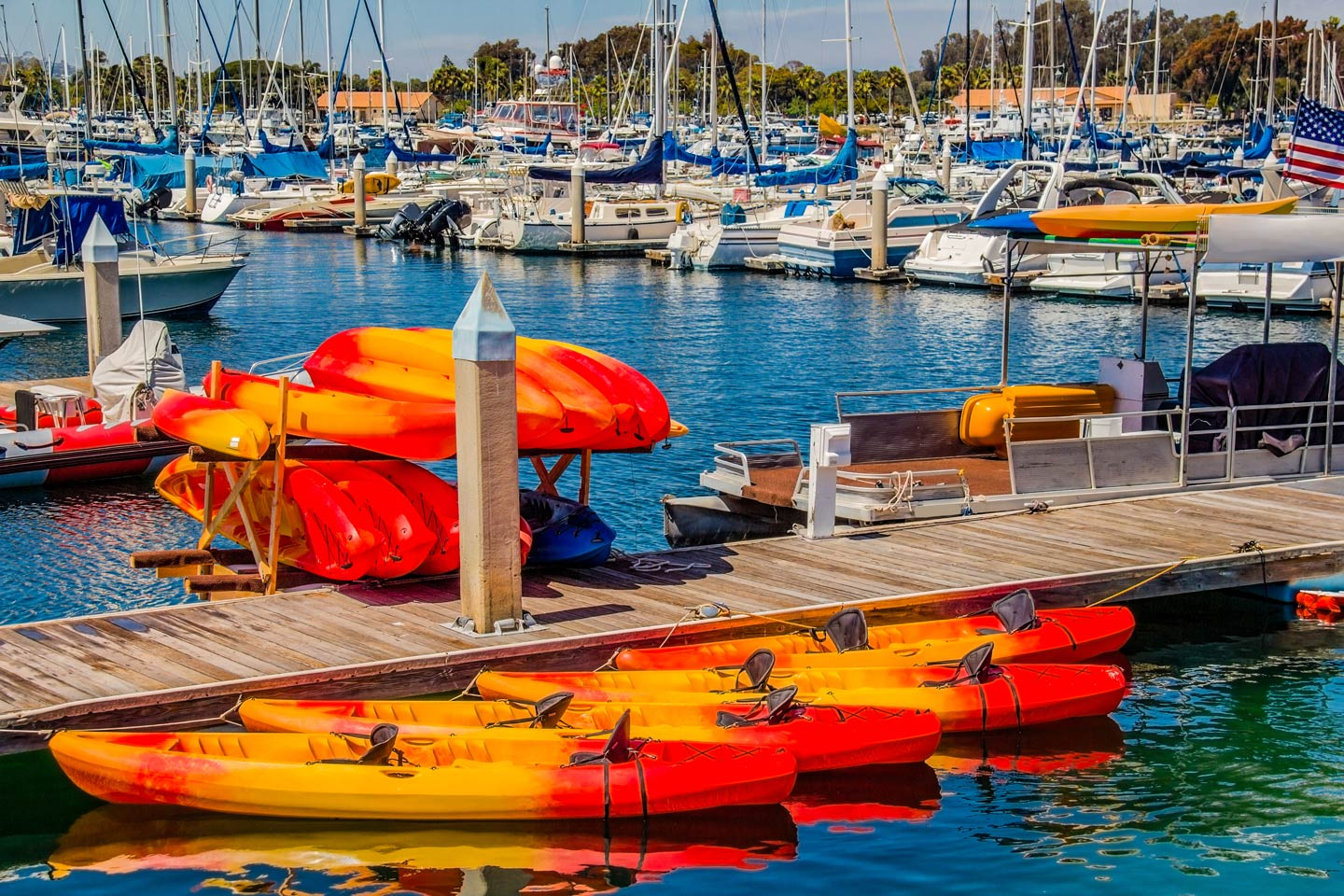 Fishing kayaks for rent at a marina in Southern California.