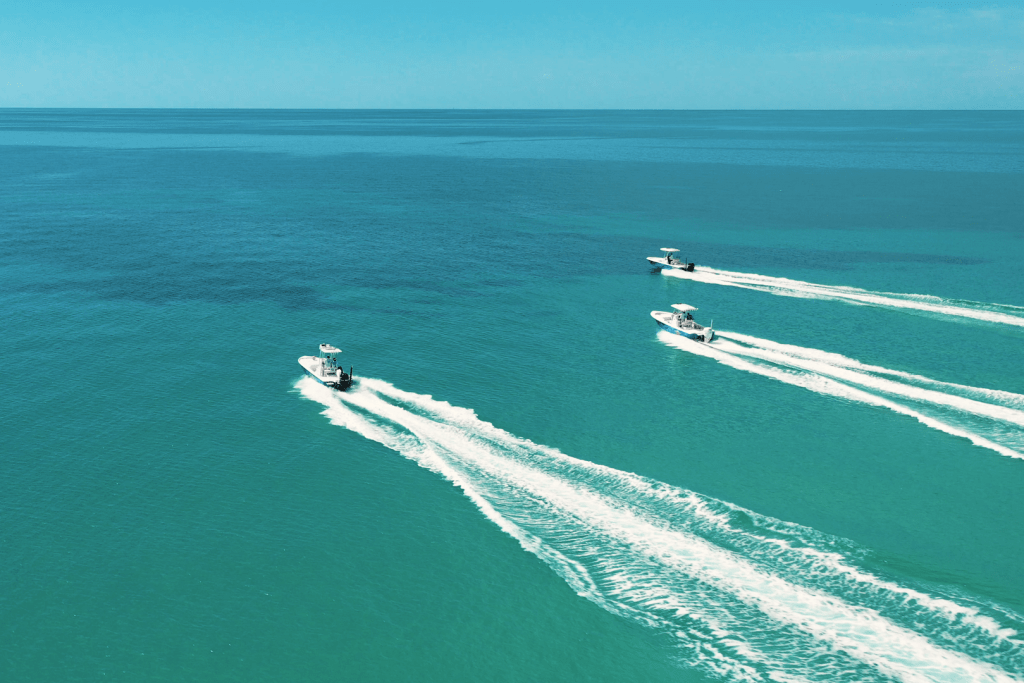 Three boats speeding offshore in the Florida Keys