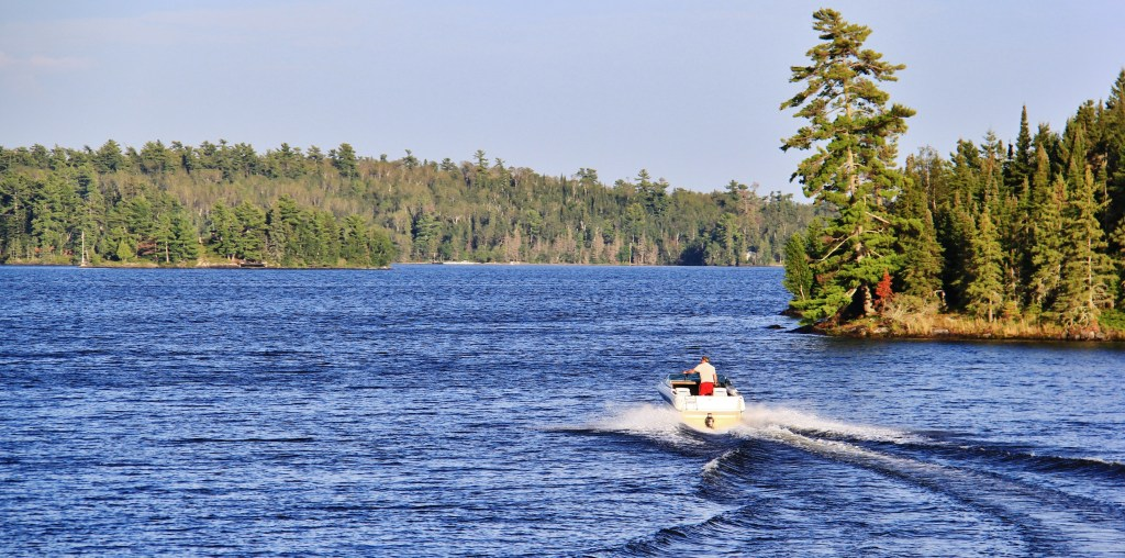 A view of the Lake of the Woods and a boat in the distance