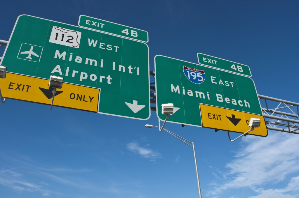 Road signs showing the turning to Miami Airport