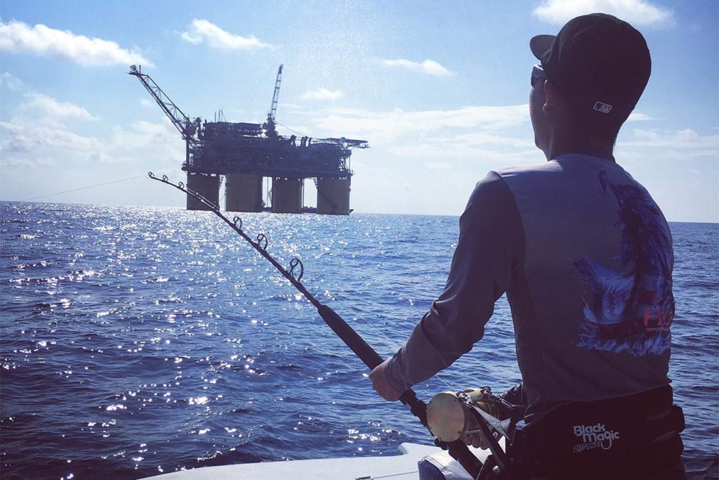 An angler bottom fishes around the oil rigs in Alabama