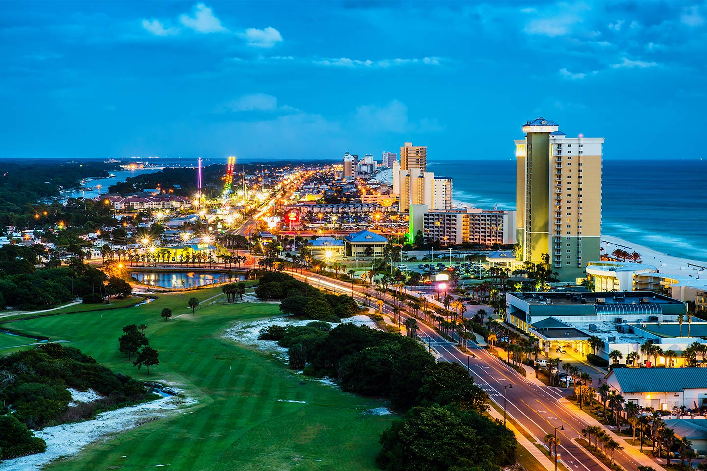 An aerial view of downtown Panama City Beach by night