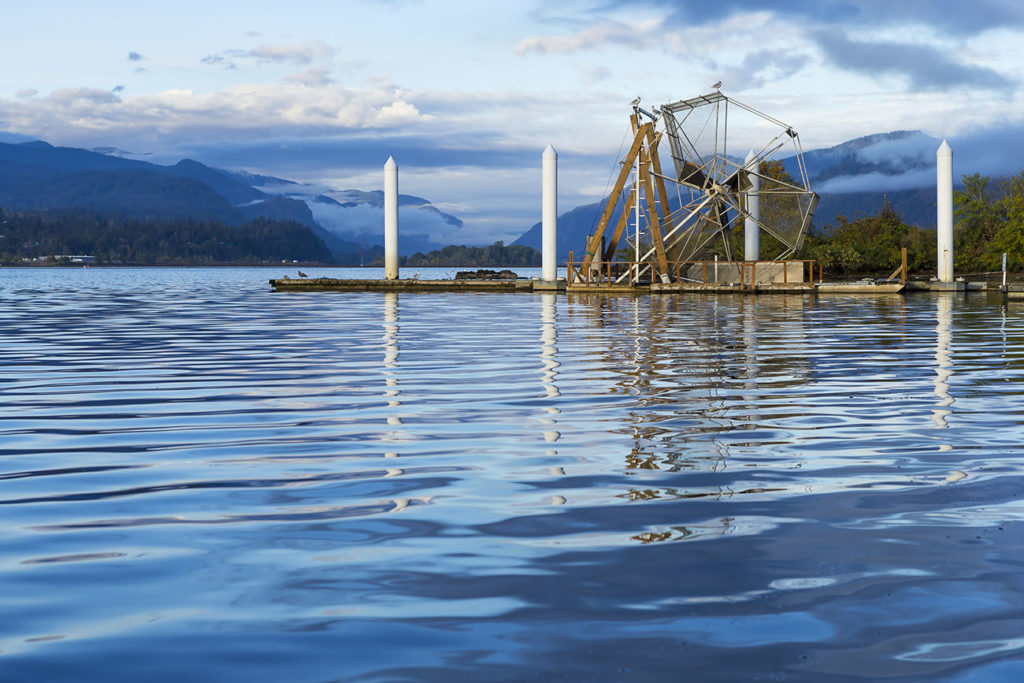 A salmon fishing wheel in a river in Alaska