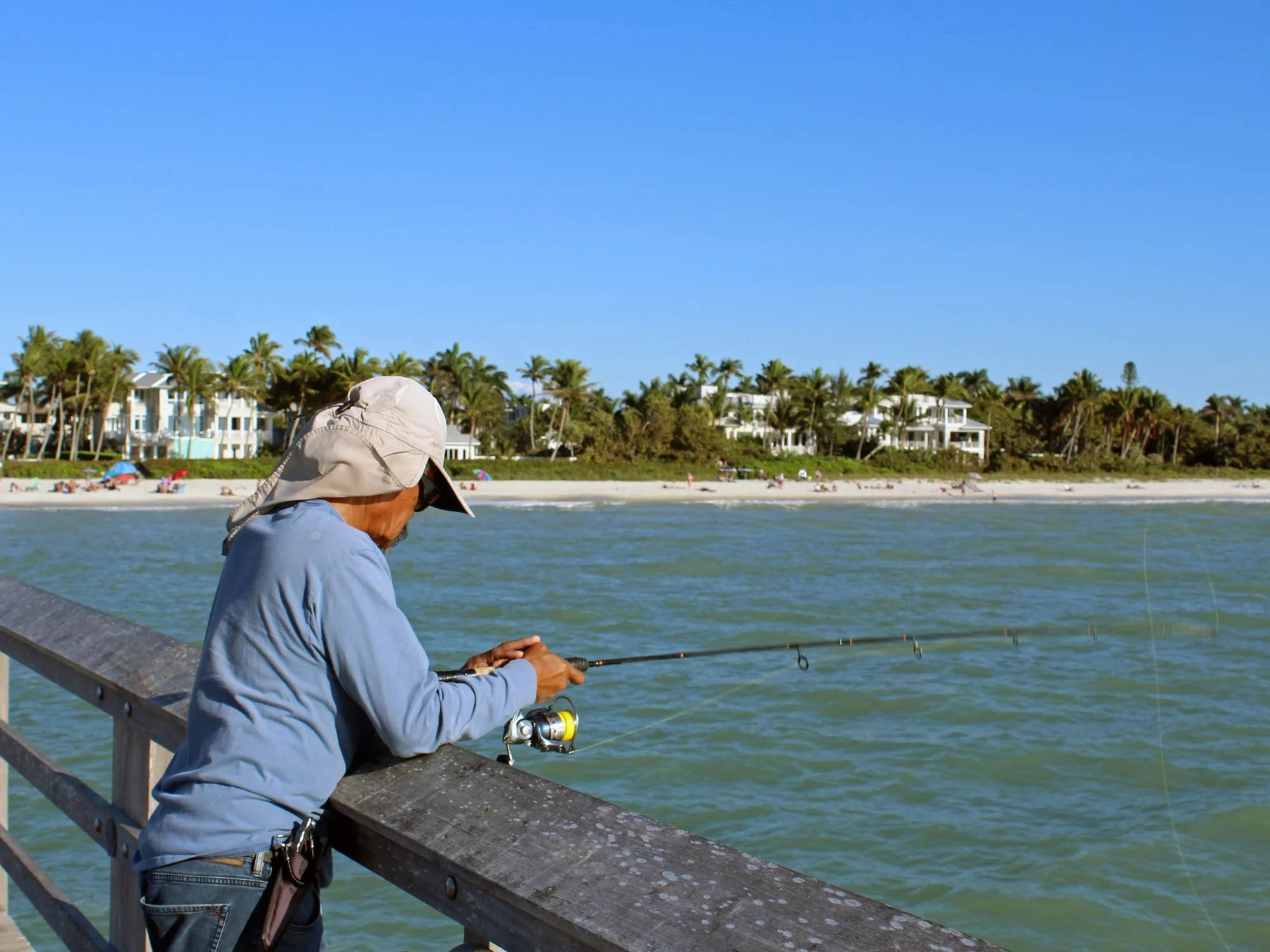 A man enjoying a relaxing day of fishing from a pier alone