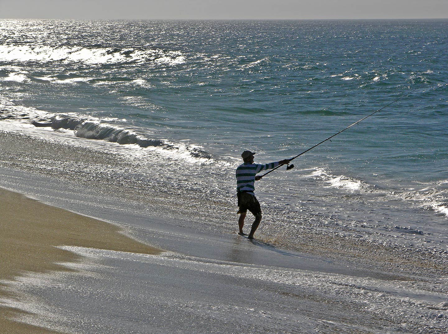 A man casts from the beach in Baja California Sur