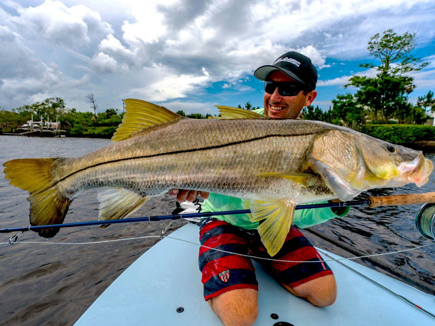 A man holding a big Snook on a boat in Jupiter, Florida