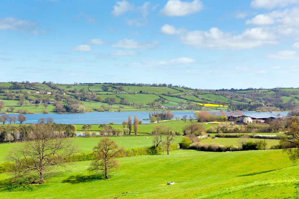 Green fields and a blue lake in Somerset