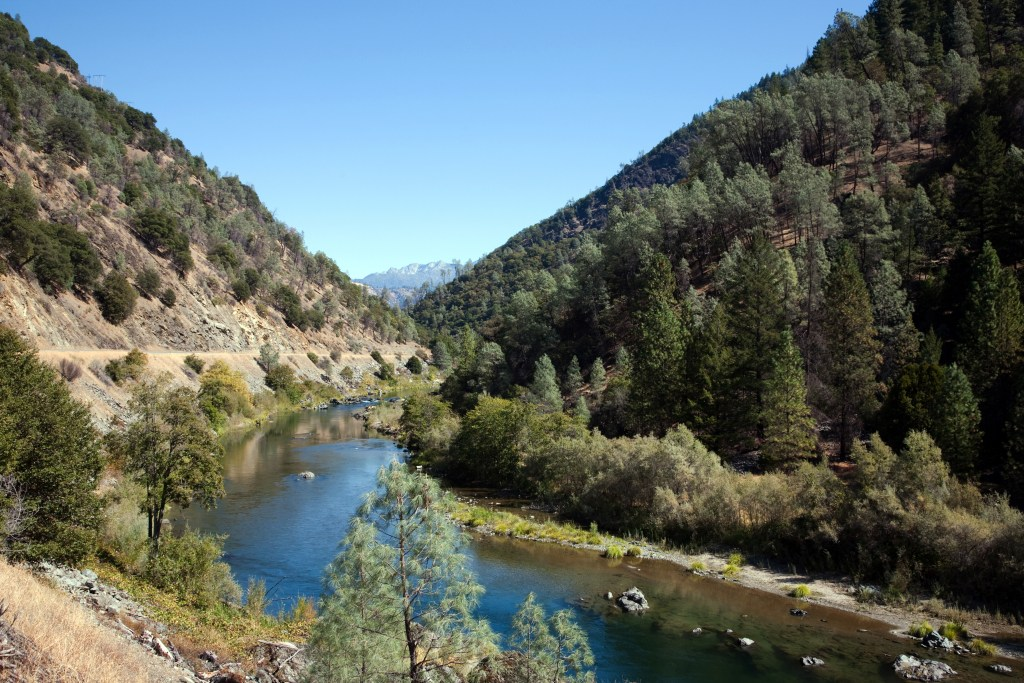 A view of the Trinity River running through the Trinity-Shasta Mountains.