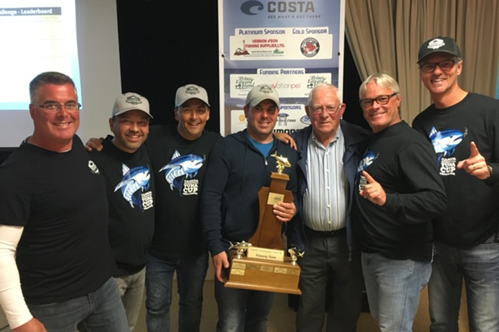 Seven people posing with a trophy after winning the PEI Tuna Cup Challenge