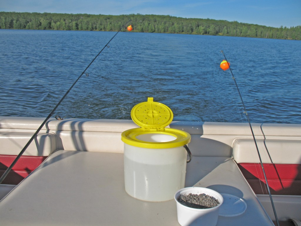 a bait bucket and some chum on a fishing boat