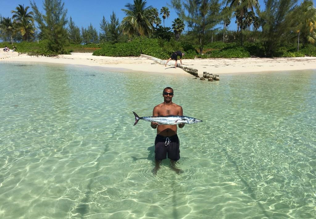 an angler holding a wahoo