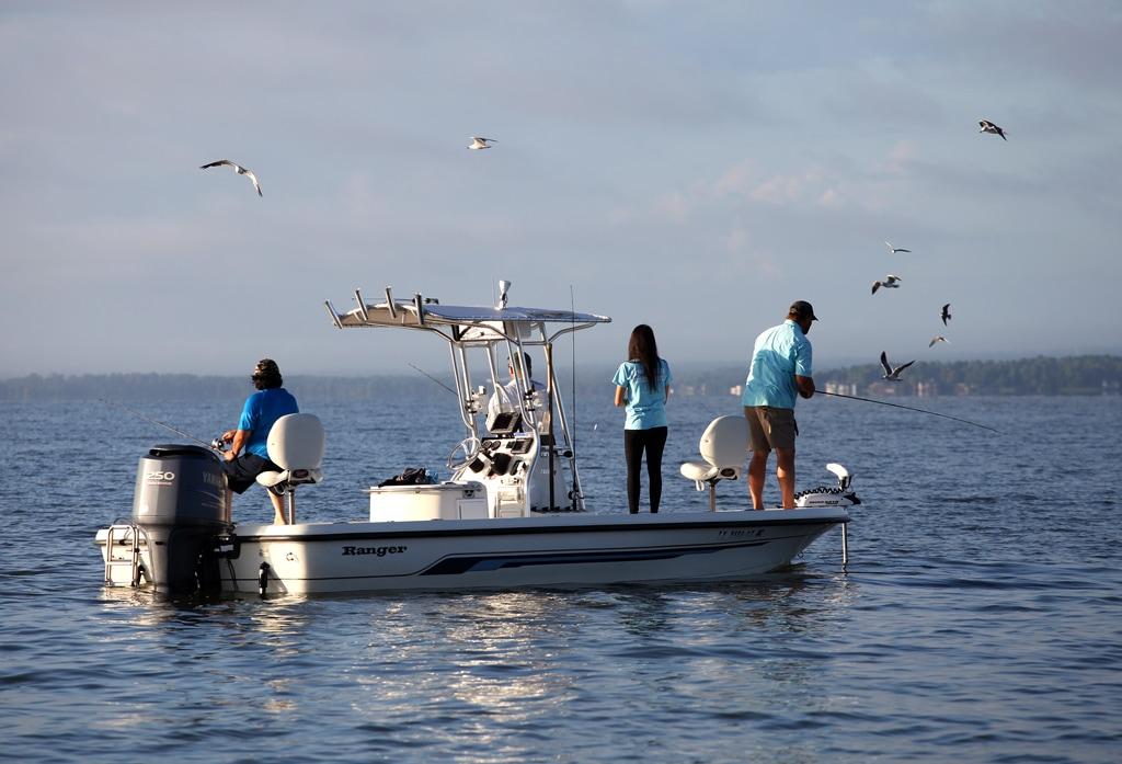 boat anglers fishing on Lake Livingston, a lake near Houston, Texas